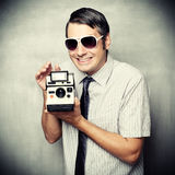 Funny guy wtih instant camera Stock Photo