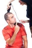 Funny hairdresser shaving man hair. Funny hairdresser shaving men with hair trimmer, isolated on white background Stock Image