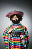 Funny hairy mexican with movie clapper Stock Photography