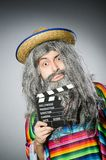Funny hairy mexican with movie clapper Royalty Free Stock Image
