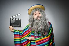 The funny hairy mexican with the movie clapper Stock Image