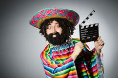 Funny hairy mexican with movie clapper Stock Photos