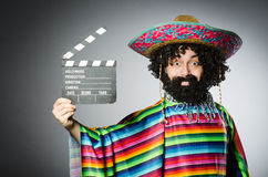 Funny hairy mexican with movie clapper Royalty Free Stock Images