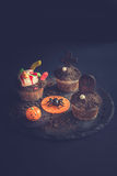 Funny Halloween cup cakes. Funny cup cakes as Halloween decoration on dark background,selective focus Royalty Free Stock Image