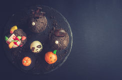 Funny Halloween cup cakes and cake pops. On dark background,blank space Stock Image