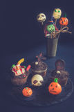 Funny Halloween cup cakes and cake pops. Funny Halloween decoration with cup cakes and cake pops,selective focus Stock Photography