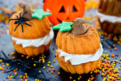 Funny Halloween cupcakes shaped pumpkin with cream, creative and Royalty Free Stock Photography