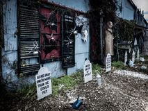 Free Funny Halloween Decorations In Front Of A Haunted House Stock Photos - 159779843