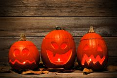 Funny Halloween Jack o Lanterns against aged wood Royalty Free Stock Images