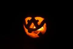 Funny halloween little pumpkin in the dark Royalty Free Stock Photo