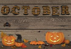 Funny halloween pumpkins with light on wooden background with letters october Stock Photos