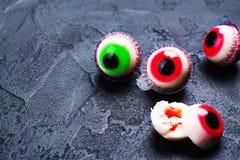 Jelly eyeballs on dark. Funny halloween treat - jelly eyeballs on dark background. Copy space Royalty Free Stock Image