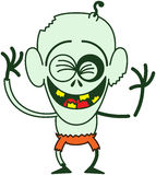 Funny Halloween zombie laughing enthusiastically. Funny bald zombie with bulging eyes, green skin, big ears and orange pants while clenching his eyes, laughing Royalty Free Stock Photo