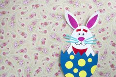 Funny handmade cartoon rabbits placed inside eggs with copyspace.  Stock Photography