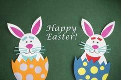 Funny handmade cartoon rabbits placed inside eggs with text Funny handmade cartoon rabbits placed inside eggs with text `Happy Ea. Funny handmade cartoon rabbits Royalty Free Stock Image