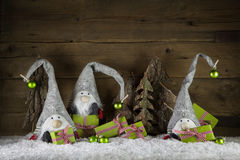 Funny handmade christmas decoration in red, white, green, brown. And red with gifts, imps and balls Stock Images
