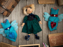 Funny handmade doll in green dress on wooden table Royalty Free Stock Photography
