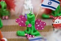 Funny handmade souvenir butterfly holding israeli flag sale at handicraft market. Israel royalty free stock images