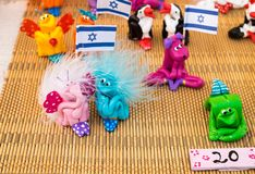 Funny handmade souvenirs holding israeli flag sale at handicraft market. Israel stock photo