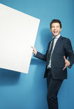 Funny handsome guy holding the board royalty free stock photography