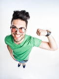 Funny handsome man with hipster glasses showing muscles - wide angle Royalty Free Stock Photo