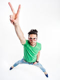 Funny handsome man with hipster glasses showing victory looking angry Royalty Free Stock Images