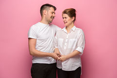 The funny handsome man and his beautiful pregnant wife`s tummy Royalty Free Stock Photos