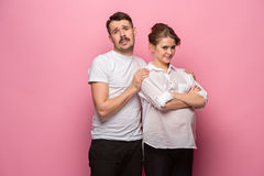 The funny handsome man and his beautiful pregnant wife`s tummy Royalty Free Stock Image