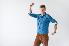 Funny handsome man showing his biceps Stock Photos
