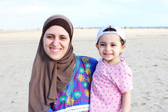 Funny happy arab muslim egyptian baby girl with her mother Royalty Free Stock Photo