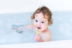 Funny happy baby taking bath and brushing teeth Royalty Free Stock Photos