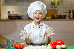 Funny happy chef boy cooking at restaurant kitchen Stock Images