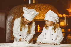Funny happy chef boy width girl cooking at Stock Photo