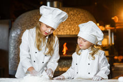 Funny happy chef boy width girl cooking at Stock Image