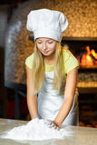 Funny happy chef girl cooking at restaurant Stock Photo