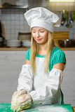 Funny happy chef girl cooking at restaurant Stock Photography