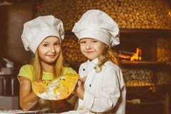 Funny happy chef girl cooking at restaurant Royalty Free Stock Photo