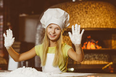 Funny happy chef girl cooking at restaurant Stock Image