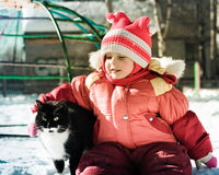 Funny happy child playing with cat. Stock Photography