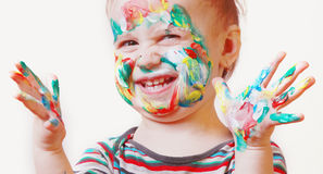 Funny happy cute little girl with colorful painted hands Royalty Free Stock Photos