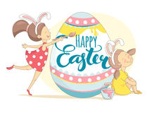 Funny Happy Easter greeting card with girls painting Easter egg. Stock Photo