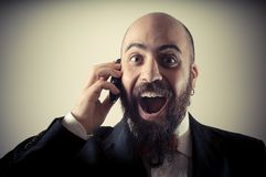 Funny happy elegant bearded man on the phone Stock Photo