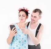 Funny happy family couple using smartphone Royalty Free Stock Image