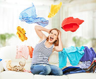 Funny happy girl with flying clothes on the sofa Royalty Free Stock Photos