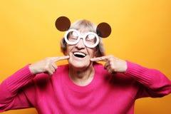 Funny grandmother posing in studio royalty free stock photo