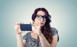 Funny happy lady with a smartphone Stock Image