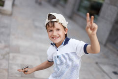 Funny happy little caucasian schoolboy at summer in cap Royalty Free Stock Images