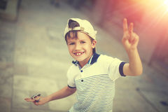 Funny happy little caucasian schoolboy at summer in cap Royalty Free Stock Photos