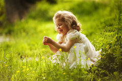 Funny happy little girl with a flower Royalty Free Stock Photography