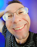 Funny happy man in glasses portrait. On vivid color background stock photo